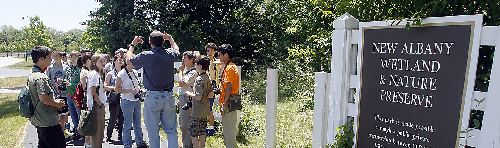 Naturalist Joe Letsche talks to students before they enter the New Albany Wetland and Nature Preserve during their class Wednesday, June 13, 2012.